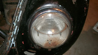Headlight, driver side.